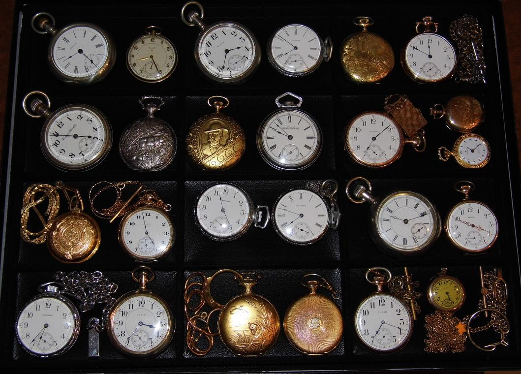 Collection_of_Vintage_Manual-Wind_Pocket_Watches_Featuring_Both_Open_Face_and_Hunter_Style_Cases_(8452100920).jpg