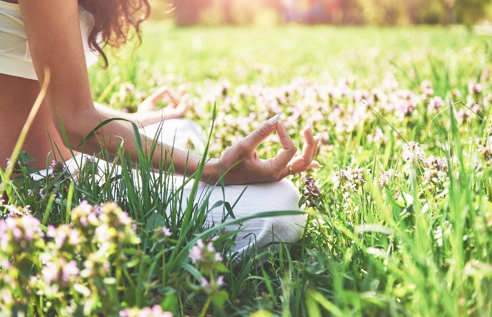 yoga-meditation-in-park-on-the-grass-is-healthy-woman-at-rest.jpg