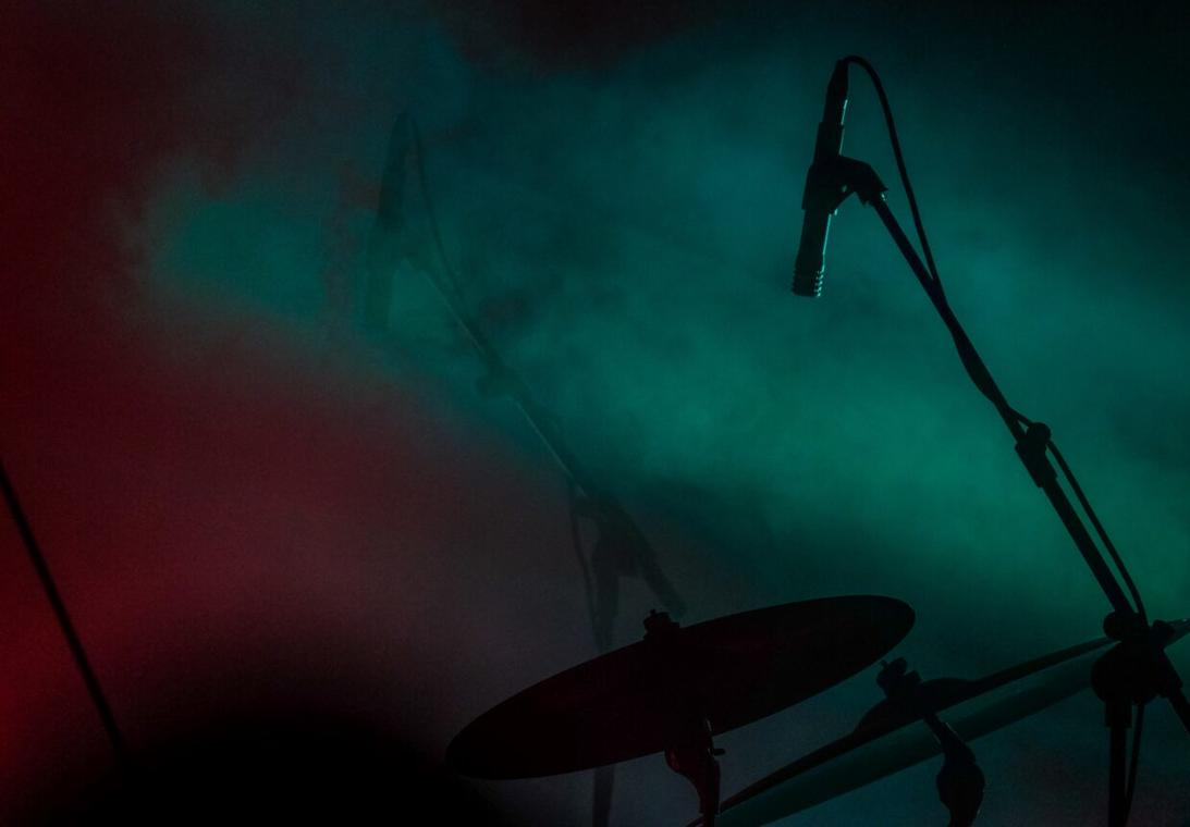 close-shot-of-microphone-near-the-drum-with-smoke-1240x862