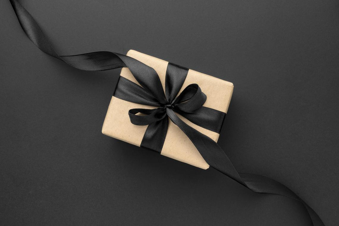 flat-lay-black-friday-sales-assortment-with-gifts