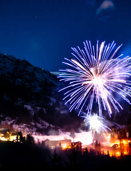 Torchlight ski down of ski instructors and New Year's Eve fireworks