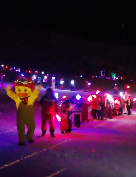 Torchlight ski down of children