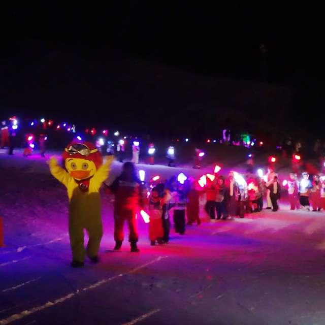 Torchlight ski down of children